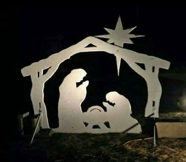 Dwa tyranozaury biją się o nowo narodzonego Chrystusa.